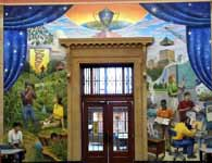 Mural in upper rotunda, showing students in classrooms and doing research
