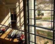 View from stairs of Parks Library, showing original building and glass wall from newest addition
