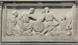 Panel on outside of building, showing four men in ancient Greek clothing, holding symbolic items