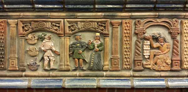 Part of frieze of tiles above mantel showing high relief modeling and conventions such as decorative columns and arches