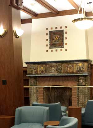 Fireplace decorated with art tiles in wood-beamed-ceilinged Fireplace Room