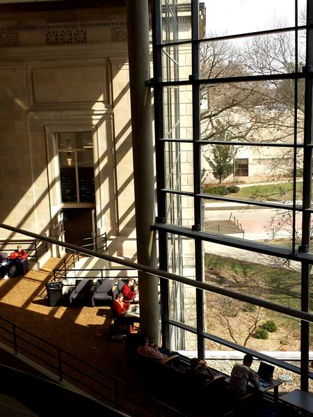 View from central stairs with glass curtain wall and original building