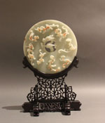 14 - Bi Disc with stand - whitish, flat with carvings, on carved wooden stand