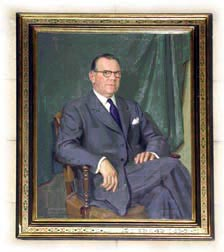 Portrait of Friley, seated in chair