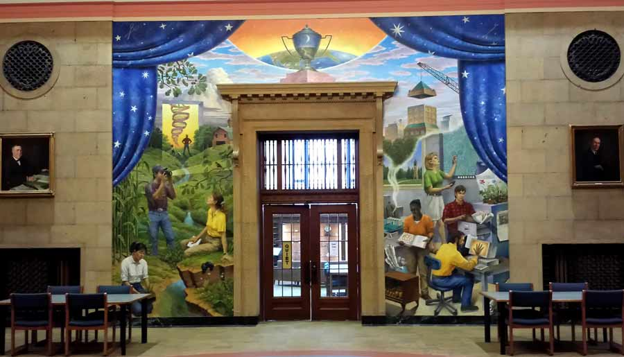 Mural, framed by deep blue curtains, scenes of students, in classrooms and doing research